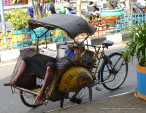 Becak driver taking a nap!