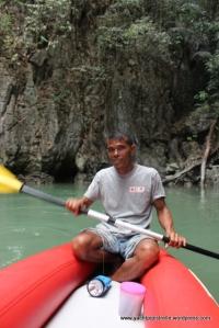 Paddling his canoe