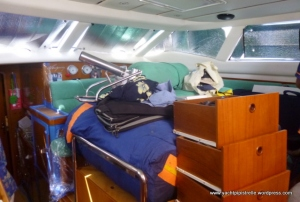 Upheaval - where to go when 2 aft cabins emptied and out of bounds so cables for solar panels could be run to engine room.   Saloon (pictured) not accessible.  Solution - owner's berth with aircon on!
