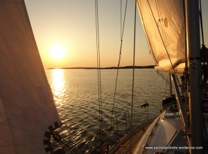 under sail at sunset