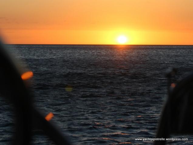 From the cockpit, enjoying crayfish at sunset