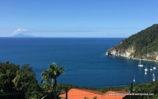 from the botanical gardens - Montserrat on horizon, Deshaies anchorage bottom right