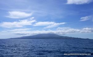 Peak peeking above the cloud on neighbouring Pico island
