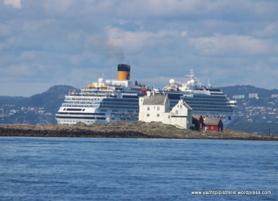 Cruise ship dwarfing lighthouse - entrance to Kristiansand