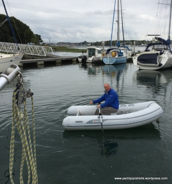 Rowing the dinghy to storage